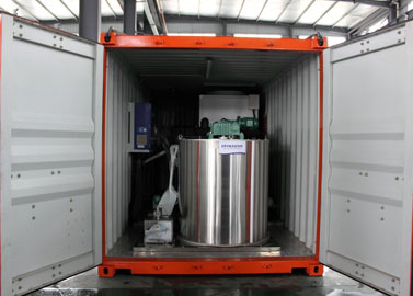 Containerized flake ice machine evaporator