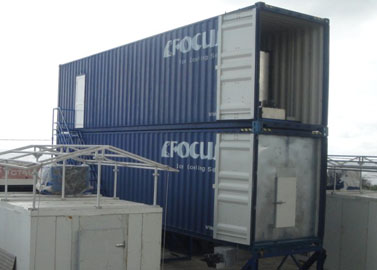Containerized flake ice machine with auto rake ice storage